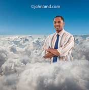 An African American businessman stands with his head and shoulders above the clouds in a metaphorical image about successful cloud computing and Internet networking.