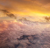 A sunset photo shot at 30,000 feet offers a breathtaking (literally) cloudscape useful as a stock photo for concepts ranging from cloud computing to