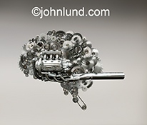 This stock photo of a human brain-shaped cluster of gears, sprockets and chains and a gas engine is symbolic of high powered brains, creativity, ideas, and artificial intelligence.