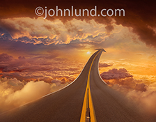 Successful cloud computing, or a highway to heaven, are just two of the concepts illustrated in this image of a highway stretching out through a brilliant high-altitude sunset in a dramatic cloudscape.