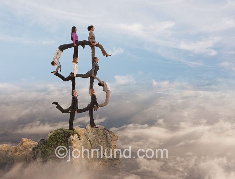 People stand on each other's shoulders above the clouds forming a human dollar sign in an image about teamwork, success and cloud computing.