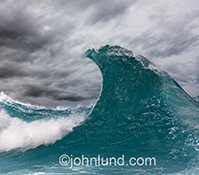 A stylized and iconic ocean wave is cresting in this stock image of a classic ocean wave as we all imagine it in our minds.