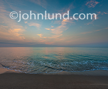 This idyllic deserted tropical beach at sunrise was photographed on South Beach in Miami Florida.