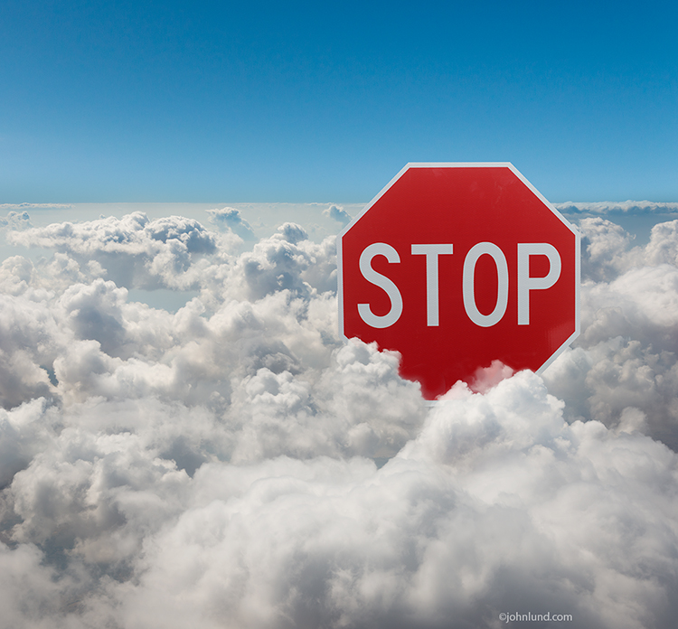 "This image of a stop sign emerging from the clouds is a metaphor for the need for caution in using the cloud and an opportunity for advertisers to deliver their messages about the products and services they provide to help insure success in ""The Cloud""."