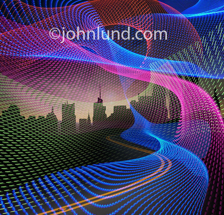 This information superhighway stock photo combines vividly colored light trails, a curvy road, and a city skyline to create a memorable and futuristic rendition of the Internet, big data, and data transmission.