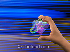Innovation is powerfully shown in this stock photo of a human hand holding a complex web of light streaks showing research, future technology, energy and creativity.