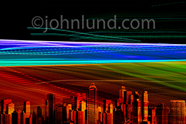 An Internet connected city is seen through light trails in a stock photo about networking, cloud computing and big data transmission.