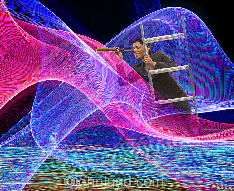 Internet searching is illustrated in this colorful stock photo of a woman, on a ladder, using a telescope to search in the midst of an intricate and complex network of colored light trails representing networks and streaming data.