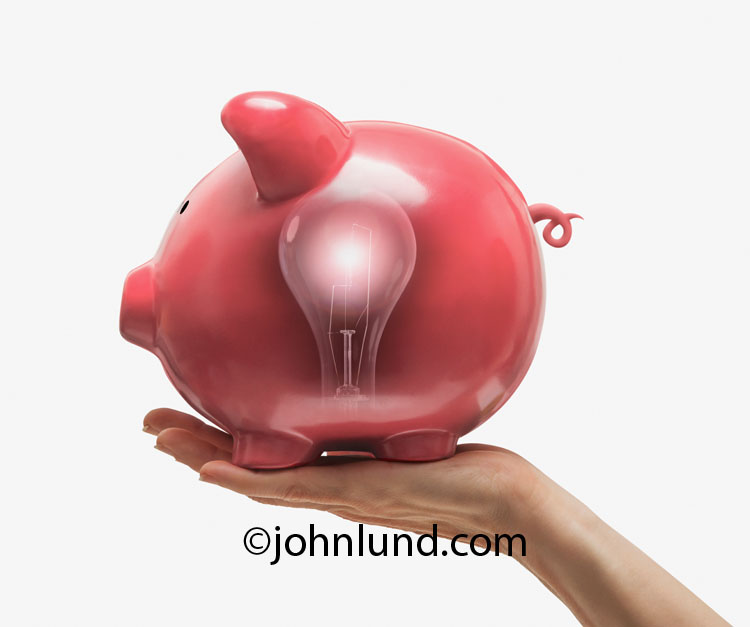 A piggy bank with a light bulb showing within is a metaphor for investment ideas and creative financing.