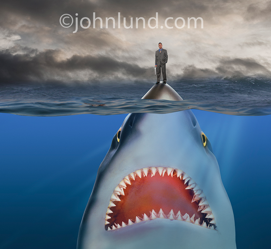 "A giant shark a la ""jaws"" lurks just below the surface of the ocean with an unsuspecting businessman standing on the tip of its nose in a humorous look at the challenges and dangers facing businesses."