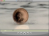 A gold South African Krugerrand Coin spins in slow motion on a marble surface in this stock video