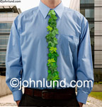 Green leaves form the tie on this businessman's shirt indicating his environmental responsibility and going green. Green Stock Photos.