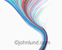 Colored light streaks carve a graceful line over a white background in a stock photo about the concepts of communications, technology, networking and connection.