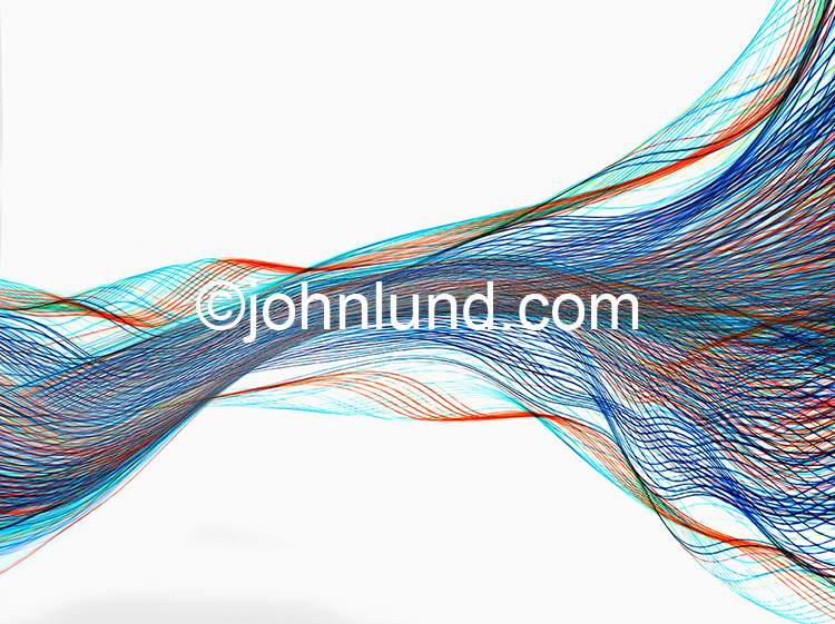 Colored light trails undulate across a white background in a stock image showing complexity, communications, networking and technology.