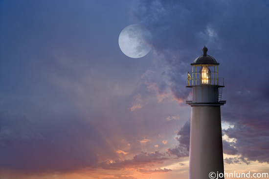 Picture Of A Lighthouse At Sunset With A Watchman Standing At The Railing And Gazing Out To Sea