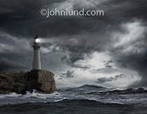 A solitary lighthouse stands at the edge of a cliff casting its beam out over the storm tossed ocean waves in a beacon of guidance, hope and safety.