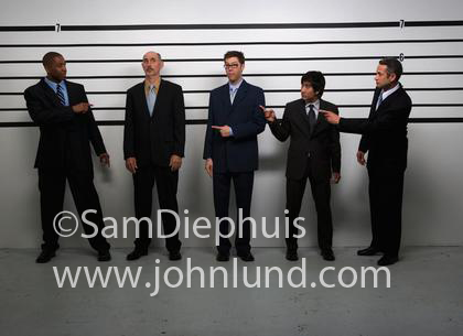 funny police line up image with everyone pointing fingers