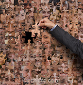 Making social media choices is the concept seen in this stock photo of a man's hand pulling a jigsaw puzzle piece from a huge puzzle of human faces.