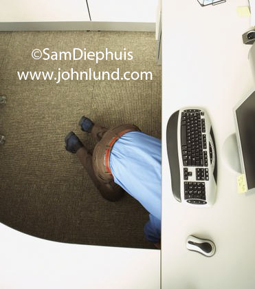 Keyboard and mouse camera looking straight down at man under desk