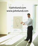 Picture of that great idea. A businessman with a drawing of a lightbulb in his presentation. Photo of a man with a drawing of a light bulb. Great idea pictures for advertising.