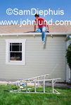 Man stranded on the roof of his house after the ladder he was using fell onto the ground. The man is doing a home improvement project. Humorous home improvement pics.