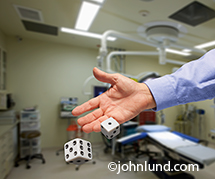 A hand rolls the dice in an operating room medical gamble in this metaphorical image about the risks and rewards in medical choices and treatments.