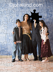 This stock photo shows a family with the face of the father omitted as in a missing jigsaw puzzle piece, an image that addresses absent fathers and the issues surrounding such absence.