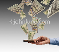 Money in the form of 100 dollar bills flow out of a smart phone held by a businessman's hand in this stock photo about cash flow, mobile banking, investment and finance.