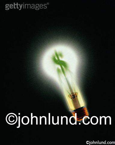 Stock photo of light bulb with a dollar sign filamment lit up green. The dramatic image is on a black background. Represents green energy and green financial investments and ideas.