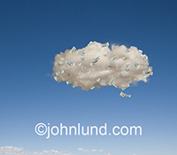 Hundred dollar bills abound in a solitary cloud in a blue summer sky in an image about profits and expenses associated with cloud computing, networking, and the Internet.