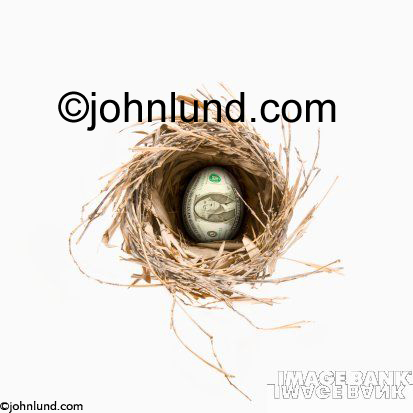 A birds nest with a golden egg in the center.  On the golden egg is the image of a US dollar bill. This money pic represents someones retirement funds or nest egg as it used to be known. Great Money Pix.