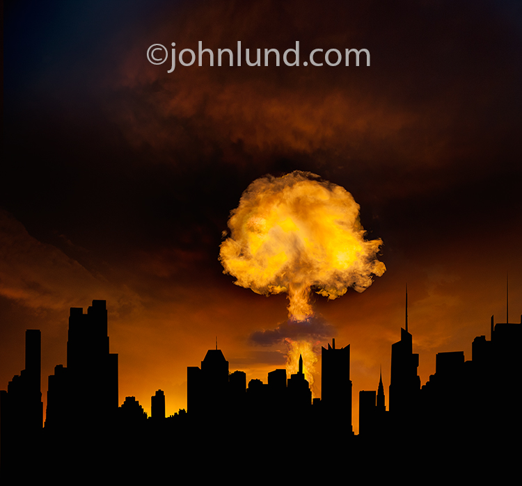 Photo of a fiery mushroom cloud rising up behind the silhouette of a large metropolis.