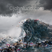 A wave of garbage surges through the ocean in a stock photo about pollution, plastic in our oceans, recycling and conservation.