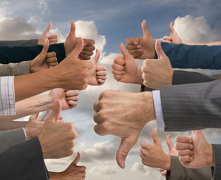 An image of multiple hands with thumbs up except for one dominant hand in the foreground with the thumb pointing down in a metaphor for the unjust solitary bad online review.
