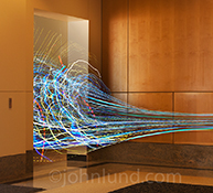 Chaos revealed: Colored light trails merge into a chaotic tangle in a stock photo about chaos, management, and business.
