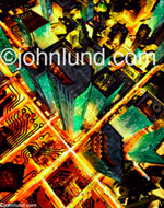 A city at night made of circuit boards. The city is Huston. The concepts are networks and communications.