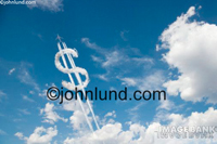 Clouds forming a dollar sign. This cloud image of a giant $ in the sky is great for advertising and editorial use. It depicts money as a lofty thing, or perhaps sky high costs.