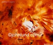 Stock photo of an exploding pressure gauge in a blast of orange, fiery dust and debris indicating excessive pressure.