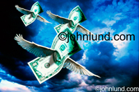 Pictures of Money: Stock photos of a trio of dollars flying through a stormy sky, currency on the move, cash flow coming in!