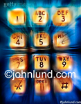 Stock photo of phone keypad with motion streaks and exagerated colors indicating the dynamic nature of pushing keys.