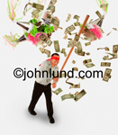 Stock shot of a blind folded man breaking a pinata full of money. Cash is flying all over the place when he breaks the pinata. Wild and crazy money pics.