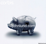 Picture of a metal piggy bank with a combination lock. The piggy bank is made of riveted steel symbolizing security and safe savings.