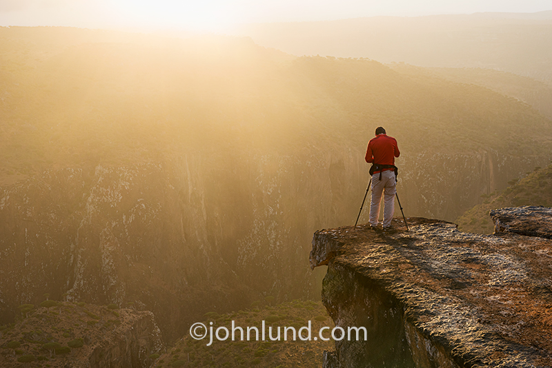 Image of Luka Esenko, dedicated photographer,shooting sunrise on Dixam Plateau in the Homhil Protected Area, Socatra island, Yemen.