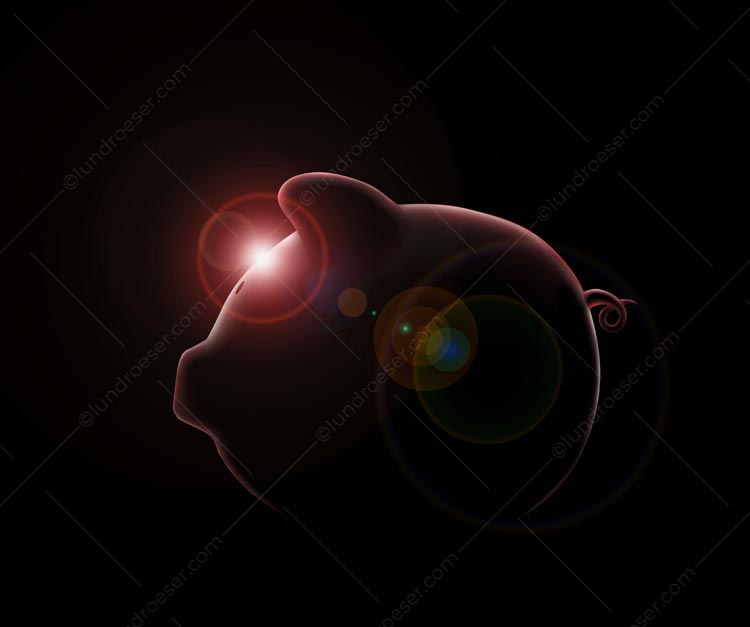 This dramatic piggy bank stock photo with a glowing light flare, and shot on a black background, makes an ideal visual for a savings and investment message.