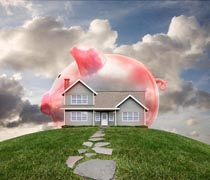 A piggy bank is superimposed over a house on a hill in a stock photo about home mortgage and finance.
