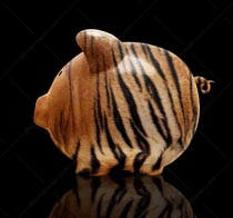 This piggy bank with tiger stripes is a stock photo about aggressive savings and investment strategies.