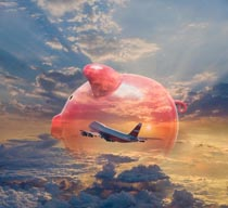 This piggy bank travel image shows a piggy bank superimposed over a 747 jet flying high above the clouds in a stock photo about saving for travel and vacations.