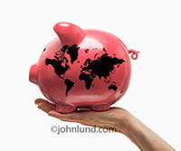 This piggy bank with a world map of continents on it represents world finance, the world bank, investment in developing countries and global investments.