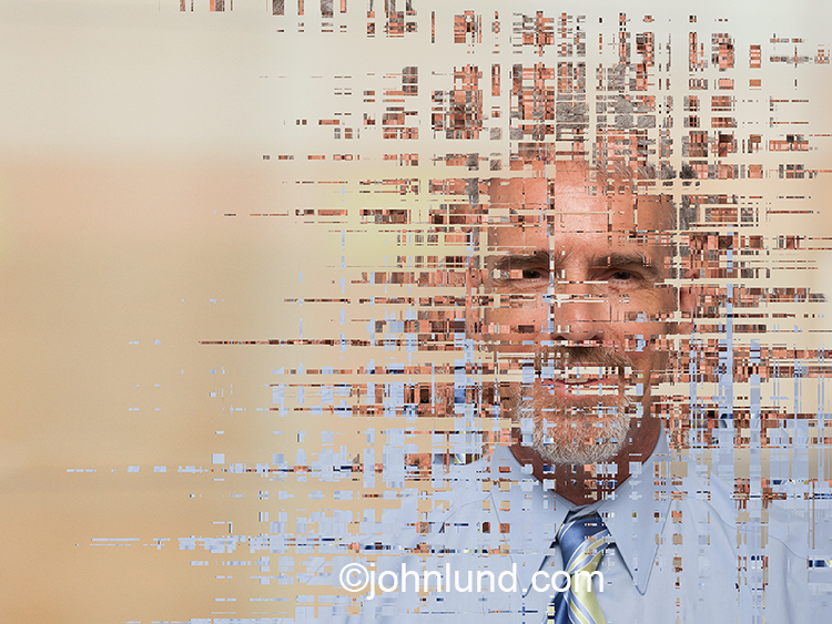 This online and pixelated businessman stock photo is a metaphor for business online, digital communications technology, cloud computing and even big data.