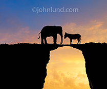 Politics, political parties, partisan politics and congressional inaction are all symbolized in this striking image of an elephant and a donkey, in silhouette, facing off against a colorful sunset.